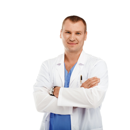 urologist: Portrait of a young male doctor in a white coat and blue scrubs against a white background