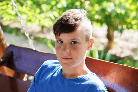preteen boy: Close-up portrait of a handsome teen boy outdoors
