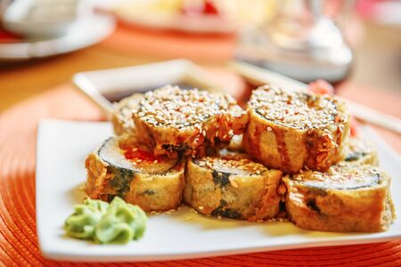 sake maki: Japanese Cuisine -Tempura Maki Sushi (Deep Fried Roll made of Smoked Eel, Crab Meat and Cream Cheese inside) with Spicy Salmon (sake) Gunkan Sushi Stock Photo