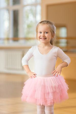 ballerina girl: Ballerina little girl standing near mirror in the gym Stock Photo