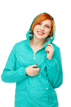 catarrh: Portrait of a young beautiful girl in a jacket with a hood isolated on white background. The onset of cold weather. Change of summer clothes for autumn. Change of winter clothing for spring. Stock Photo