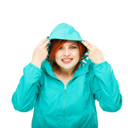 catarrh: Portrait of a young beautiful girl in a jacket with a hood isolated on white background. Change of summer clothes for autumn. Change of winter clothing for spring. Weather forecast, metcast