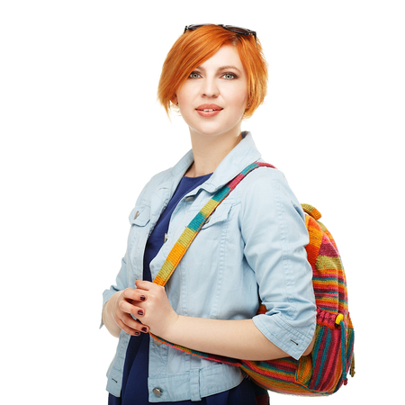 diligent: Portrait of diligent girl student university or college with colored backpack Isolated on white background
