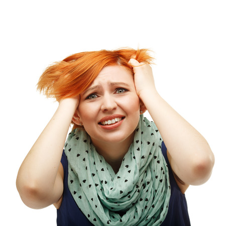 mimicry: Close-up portrait of a funny red-haired girl emotionally gesticulating and waving his hands isolated on white background. Portrait of the girl tearing their hair. Mimicry