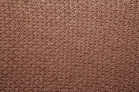 abstract seed: Seed stitch in brown yarn as an abstract background texture