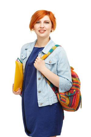 diligente: Retrato de chica estudiante diligente con carpetas y universitario mochila o universidad con el morral de colores aislados sobre fondo blanco Foto de archivo
