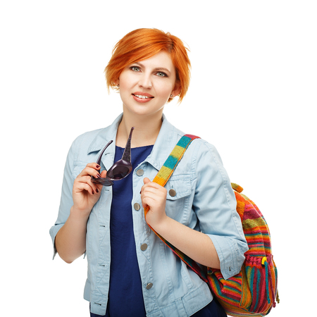 diligente: Portrait of diligent girl student university or college with colored backpack Isolated on white background