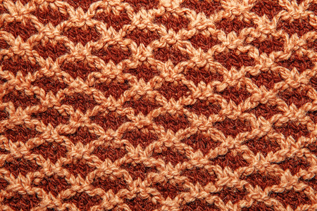 bulging: Brown knitted cloth is made by hand. It is decorated with pineapple bulging pattern. Stock Photo