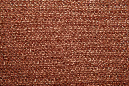 close knit: Close up on knit woolen fur texture. Brown fluffy woven thread sweater as a background. Stock Photo