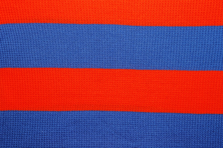 saturated: Close-up of saturated red and blue line pattern on shirt