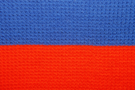 saturated: Close-up of saturated red and blue line pattern on cloth