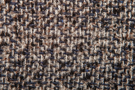 Varicolored tweed like texture, varicolored wool pattern, textured  melange upholstery fabric background copy space.  Background texture of twill