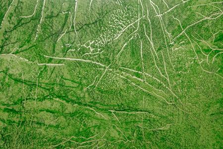 linoleum: linoleum texture background. Linoleum with green abstract pattern with golden streaks