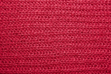 close knit: Close up on knit woolen fur texture. crimson fluffy woven thread sweater as a background.