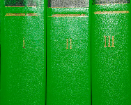 volumes: Volumes of old books with gold lettering on the cover with Roman numerals