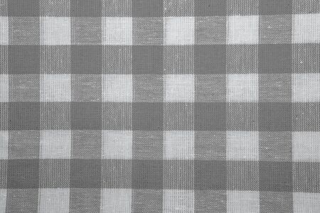 checked fabric: The texture of checkered fabric as a background. Checked fabric tablecloth. Fabric in a large square. Texture plaid fabric