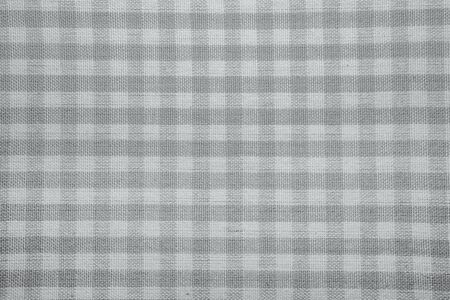 checked fabric: The texture of checkered fabric as a background. Checked fabric tablecloth. Fabric in a small square. Texture plaid fabric. Texture background of kitchen towels