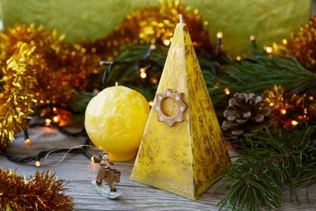 doublet: Decorative Handmade candles in the shape of a pyramid and sphere