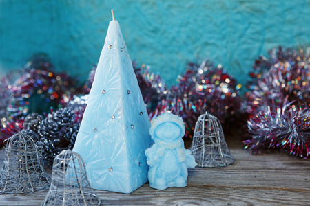 doublet: Decorative Handmade candles in the shape of a pyramid and snowman