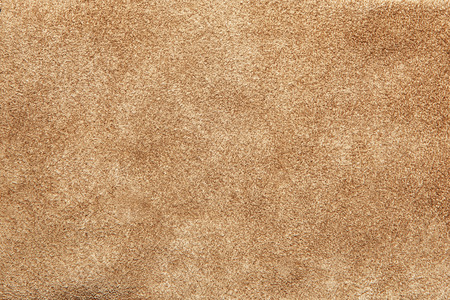 Beige suede soft leather as texture background. Old leather. Brown chamois texture. Fluffy and soft shammy-leather. Close up shammy leather texture Stock Photo - 53005955