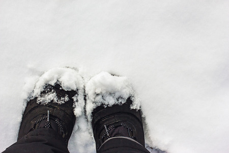 impermeable: Black Boots in the snow