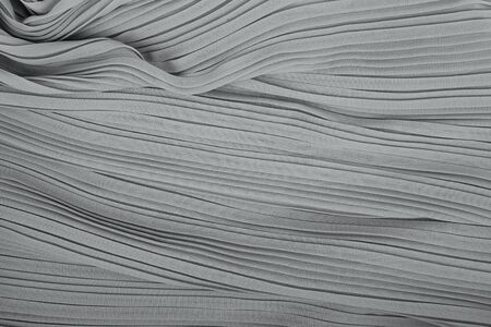 pleated: plisse fabric background texture. pleated skirt fabric texture. closeup pleated fabric texture pattern Stock Photo