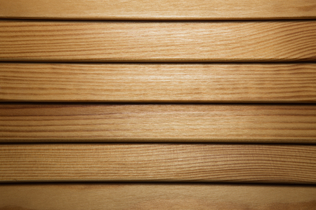 wooden louvers background texture. wood blinds closeup Stock Photo