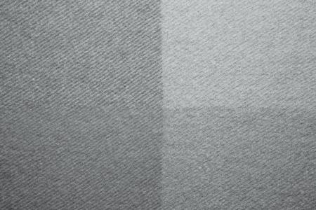 Soft and warm folded alpaca wool blanket. Grey wool plaid texture macro shot. Wool plaid texture Wool blanket