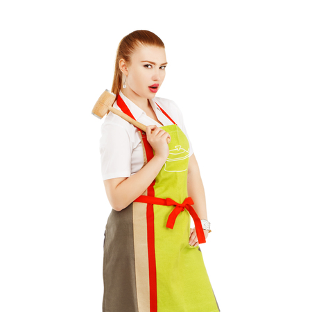 sexy housewife: Angry housewife with a meat hammer in her hands. Sexy housewife or baker chef wearing kitchen apron holds meat hammer isolated on white background