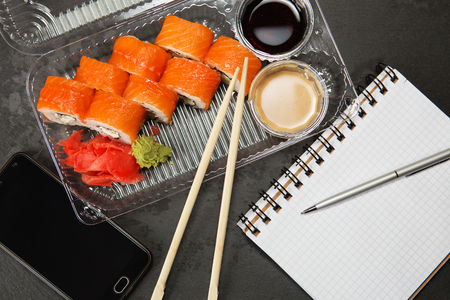 philadelphia roll: Sushi roll philadelphia. Philadelphia roll in Disposable Plastic Food Container. Business lunch concept Stock Photo