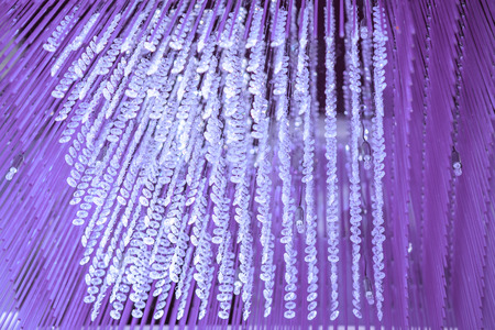 chandelier background: Modern glass chandelier. Decorative Violet crystal chandelier on the ceiling - interior decoration abstract background. Abstract background texture