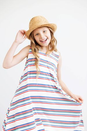Beautiful little girl with straw hat