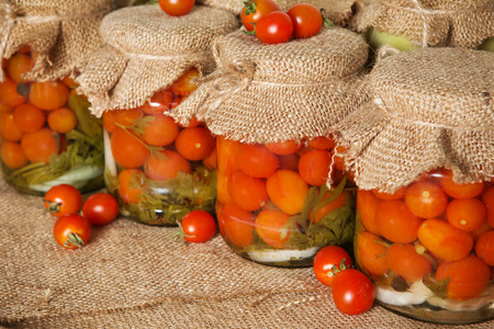 Transparent banks with marinated Cherry tomatoes. Home canning. Banks pickled tomatoes