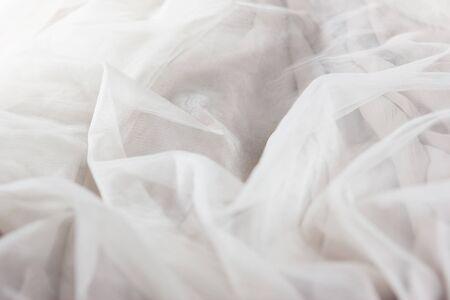chiffon tulle fabric textured background. pleated skirt fabric texture. closeup plisse fabric texture pattern