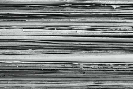 paper stack: A stack of old dilapidated folders. Old paper texture background Stock Photo