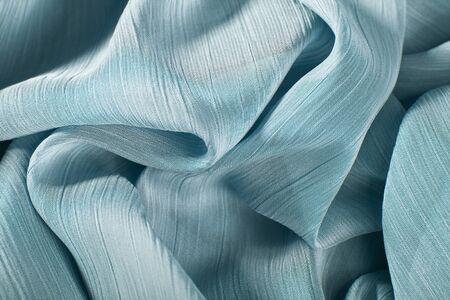 pleated: chiffon fabric background texture. pleated skirt fabric texture. closeup plisse fabric texture pattern