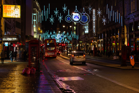 omnibus: LONDON - NOVEMBER 17, 2016: Strand street with Christmas decorations and car light trails