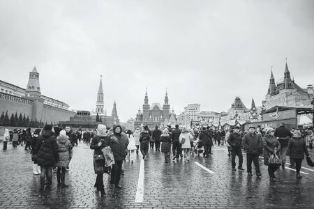 spasskaya: MOSCOW - JANUARY 02, 2017: Tourists walk on Red Square. Black and white photography Editorial