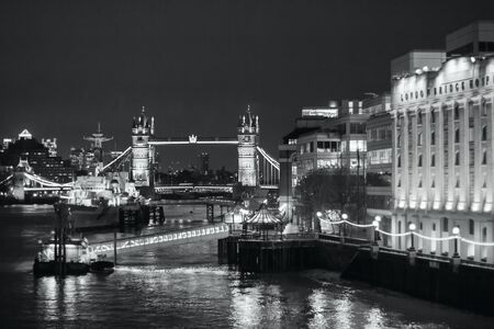 LONDON - NOVEMBER 17, 2016: Tower bridge at night, view from the River Thames. Black and white photography