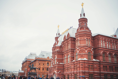 MOSCOW - JANUARY 02, 2017: Many tourists walk on Red Square. Historical Museum Building