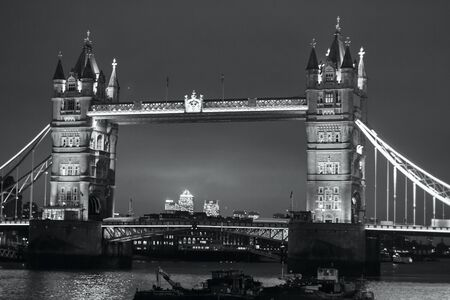 typically british: LONDON - NOVEMBER 14, 2016: Tower bridge at night, view from the River Thames. Black and white photography Editorial