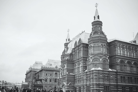 MOSCOW - JANUARY 02, 2017: Many tourists walk on Red Square. Historical Museum Building. Black and white photography Editorial