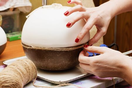 Female hands decorating handmade candles. Stock Photo
