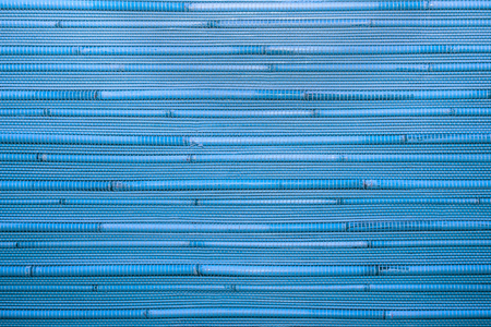 Dry reeds texture. Organic nature wallpaper of blue cane. Natural warm wooden background with bamboo and straw