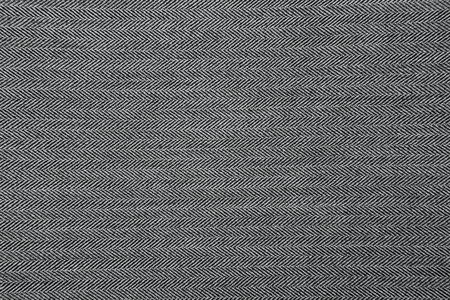 Grey herringbone fabric pattern texture background closeup