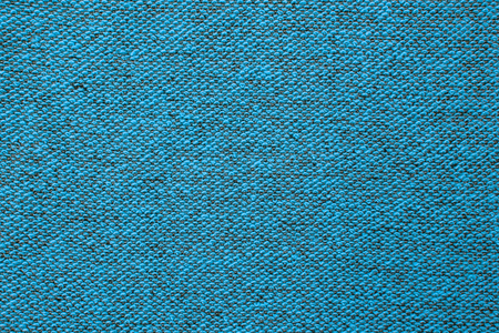 Macro shot of a terrycloth texture background. Textile floor covering. Knotted-pile carpet