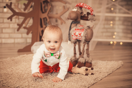 handsome little baby boy among Christmas decorations Stock Photo