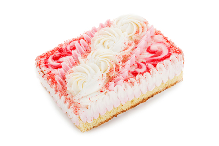 condensed: pink biscuit cake decorated with cream flowers isolated on white background Stock Photo