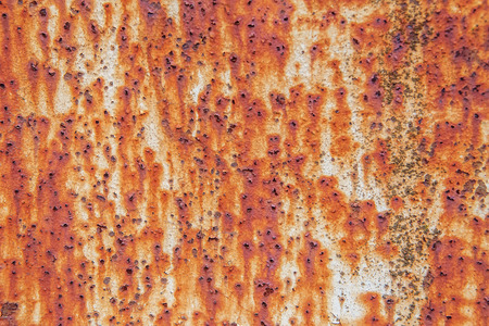 Rusty metal wall background with streaks of rust. Rust stains. Stock Photo
