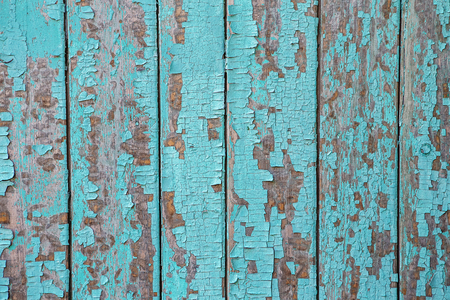of irradiated: Cracking and peeling turquoise paint on a wall. Vintage wood background with blue peeling paint. Old board with Irradiated paint Stock Photo